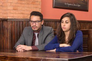 unhappy couple sitting at table