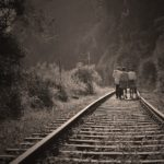 walking down railroad tracks